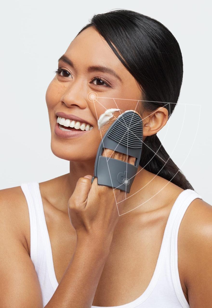Women stimulating facial skin